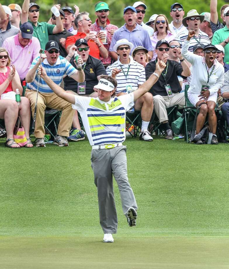 Bubba Watson rejoices when a long birdie putt goes down on No. 14. He had  five birdies in a row from Nos. 12-16. Photo: TIM DOMINICK, MBR / The State