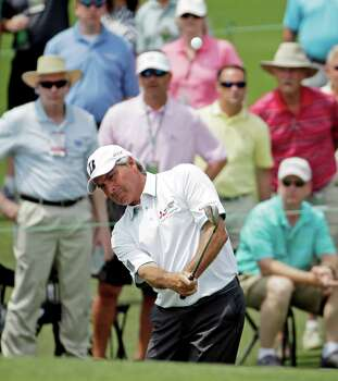 Ageless Fred Couples, who won the 1992 Masters, is again in the hunt at 2-under 142. Photo: Chris Carlson, STF / AP