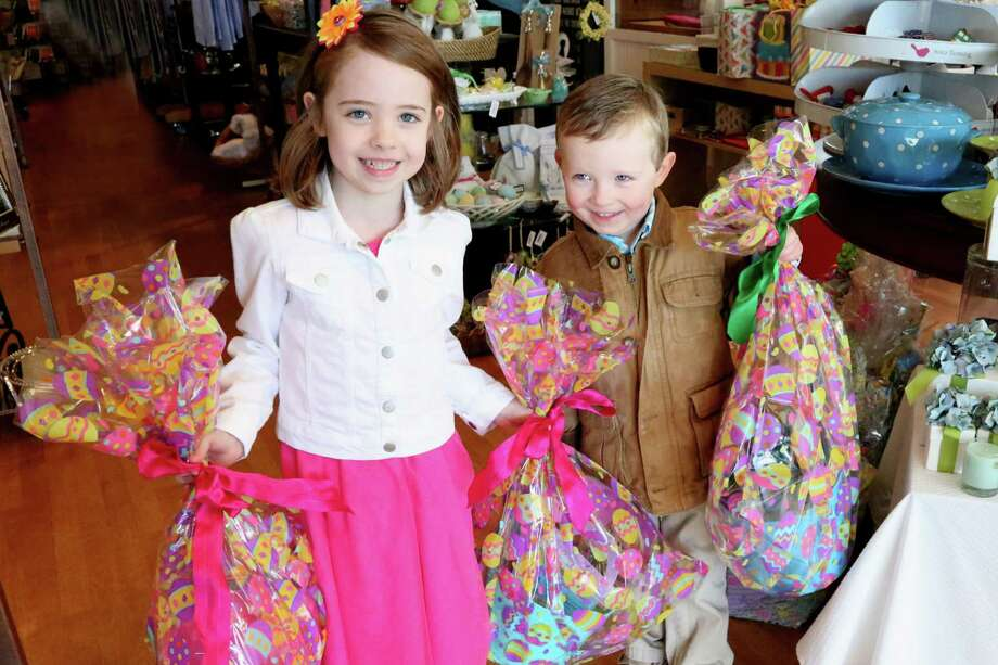 Elizabeth and Colin Walsh bring in Easter Baskets that their family is donating to Splurge, the gift store at 39 Lewis Street in Greenwich, which in turn, will distribute the baskets to Kids in Crisis and The Food Bank of Lower Fairfield County. Photo: Anne Semmes / Greenwich Time