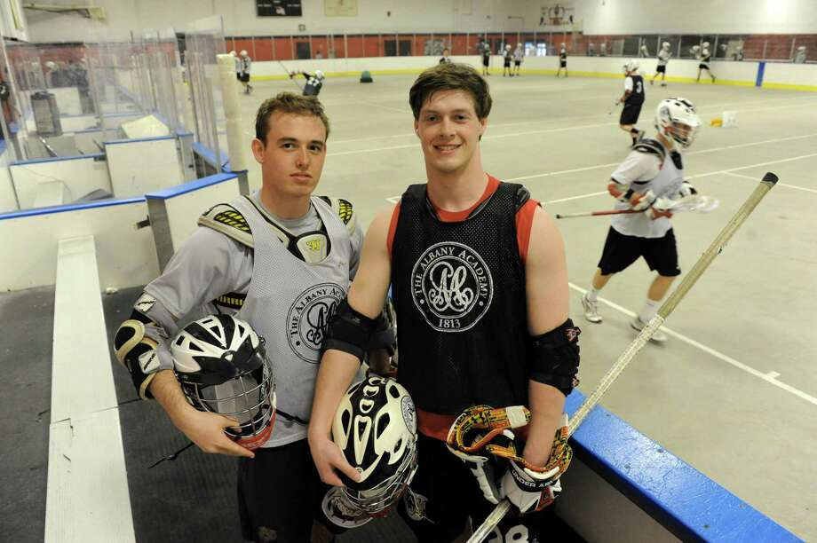 Albany Academy boys' lacrosse players Matt Balter, left, and Connor Flood during practice on Friday April 11, 2014 in Albany, N.Y. (Michael P. Farrell/Times Union) Photo: Michael P. Farrell / 00026406A