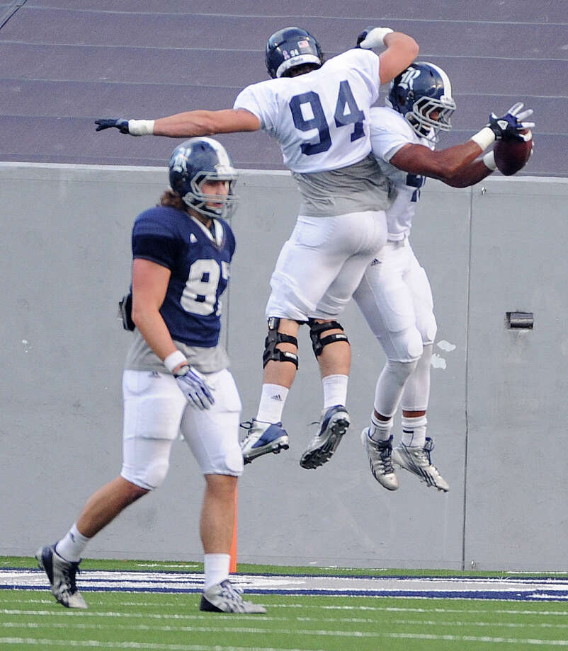 Rice Gray safety Gabe Basker, right, celebrates his touchdown with Graysen Schantz as Rice Blue tight end Connor Cella, left, looks on during the first half of Rice's spring football game, Friday, April 11, 2014, at Rice Stadium in Houston. Photo: Eric Christian Smith, For The Chronicle