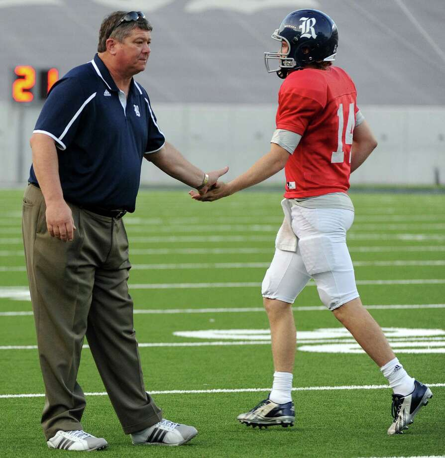 Rice head coach David Bailiff, left, congratulates Rice Blue quarterback Guy Billups after a touchdown during the first half of Rice's spring football game, Friday, April 11, 2014, at Rice Stadium in Houston. Photo: Eric Christian Smith, For The Chronicle