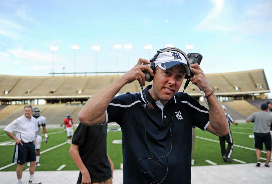 Houston Astros' president and Rice guest coach Reid Ryan dons his headset on the sidelines before Rice's spring football game, Friday, April 11, 2014, at Rice Stadium in Houston. Photo: Eric Christian Smith, For The Chronicle