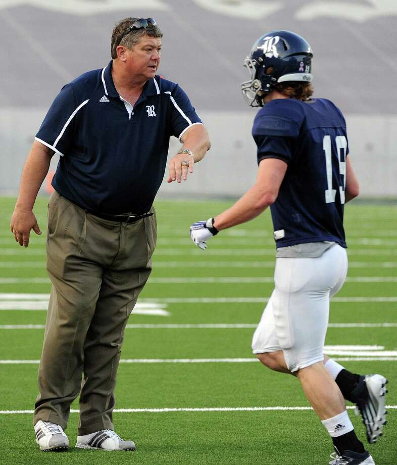 Rice head coach David Bailiff, left,  congratulates Connor Leisz after a Rice Blue touchdown during the first half of Rice's spring football game, Friday, April 11, 2014, at Rice Stadium in Houston. Photo: Eric Christian Smith, For The Chronicle