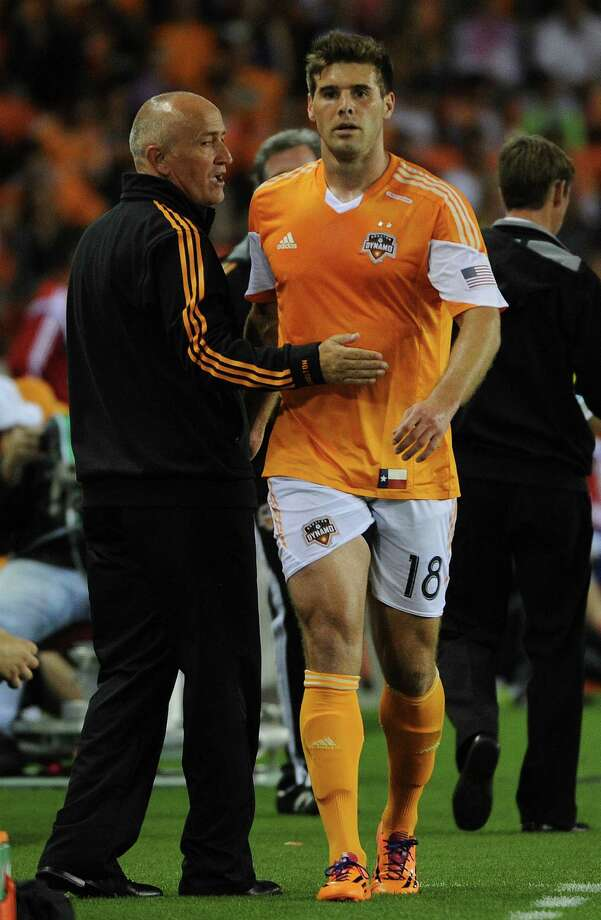 Dynamo coach Dominic Kinnear, left, is in a bind at center back due to injuries and a red card on David Horst, right. Photo: Eric Christian Smith, Freelance