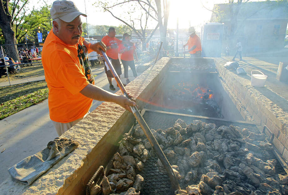With 70,000 hungry revelers expected, Ernie Alcala gets cooking Friday at the St. Mary's University Oyster Bake. Photo: Tom Reel / San Antonio Express-News