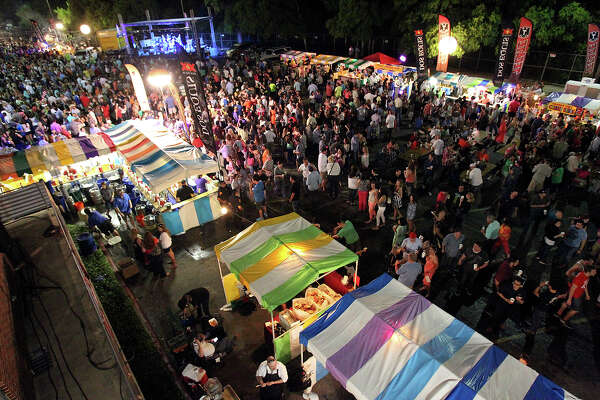 Crowds pack the midway at Alamo Heights Night at The University of the Incarnate Word on April 11, 2014.