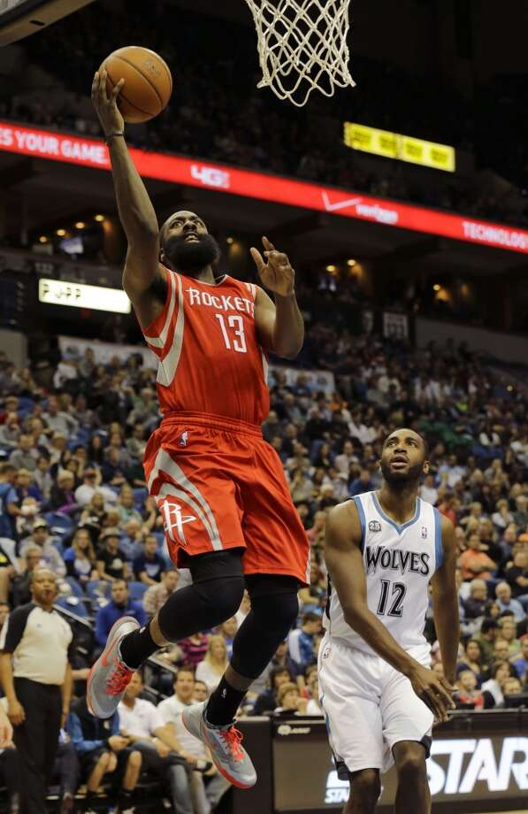 April 11: Timberwolves 112, Rockets 110  Rockets guard James Harden (13) goes up for a shot in front of Timberwolves forward Luc Richard Mbah a Moute. Photo: Ann Heisenfelt, Associated Press