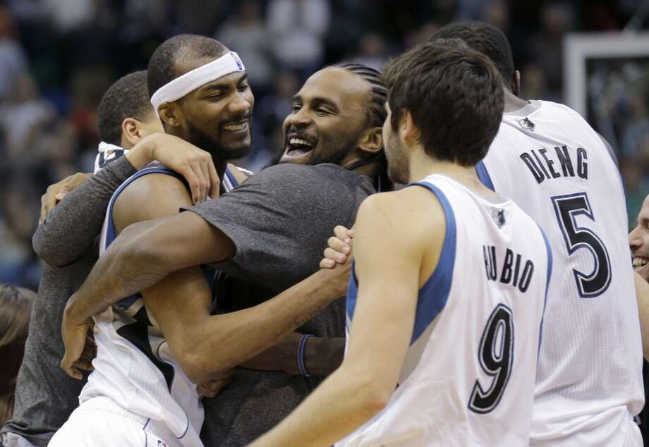 Timberwolves forward Corey Brewer, left,  celebrates with teammates Ronny Turiaf, center, of France; Ricky Rubio (9), of Spain; and Gorgui Dieng. Photo: Ann Heisenfelt, Associated Press