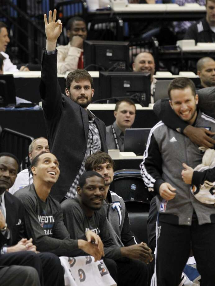 Timberwolves forward Kevin Love cheers on his teammates from the bench. Photo: Ann Heisenfelt, Associated Press