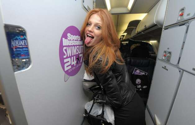 NEW YORK - FEBRUARY 09:  Sports Illustrated swimsuit model Cintia Dicker boards the Sports Illustrated Swimsuit 24/7: New York To Las Vegas Air Tran Flight on February 9, 2010, New York City. (Photo by Michael Loccisano/Getty Images for Sports Illustrated) *** Local Caption *** Cintia Dicker Photo: Michael Loccisano, Getty Images For Sports Illustra / 2010 Getty Images