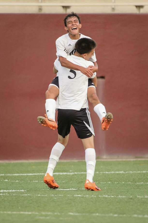 Pasadena's Luis Cayon jumps into the arms of Andres Munoz after their playoff victory. Photo: ÂKim Christensen, Photographer / ©Kim Christensen