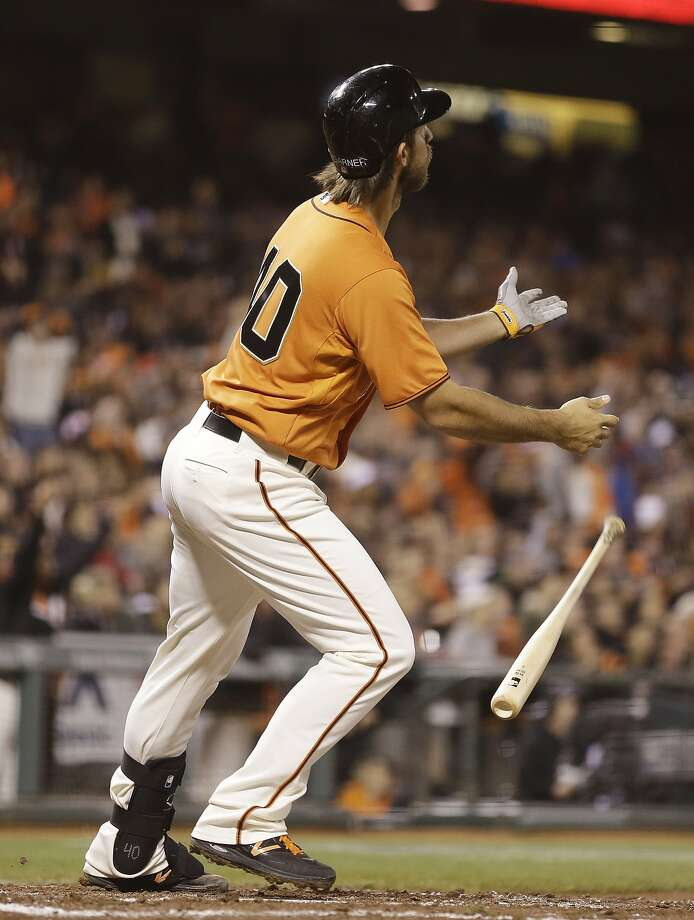 Madison Bumgarner's fourth-inning grand slam heads for the cheap seats. Photo: Eric Risberg, Associated Press