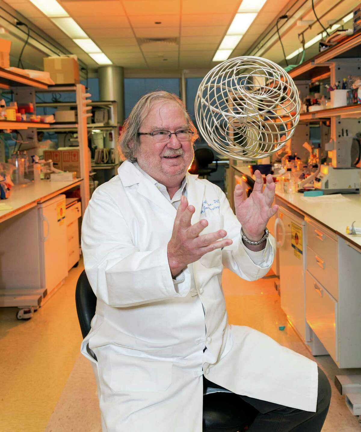 """Jim Allison, Ph.D., an M.D. Anderson researcher whose ground breaking research enabled doctors to enlist the immune system to fight cancer. For Sunday story on the new approach. With important """"Breakthrough Prize in Life Sciences"""" in his lab at the McCombs Institute for the Early Detection and Treatment of Cancer, 7555 Fannin Street. 1/24/14 (Craig H. Hartley/For the Chronicle)"""