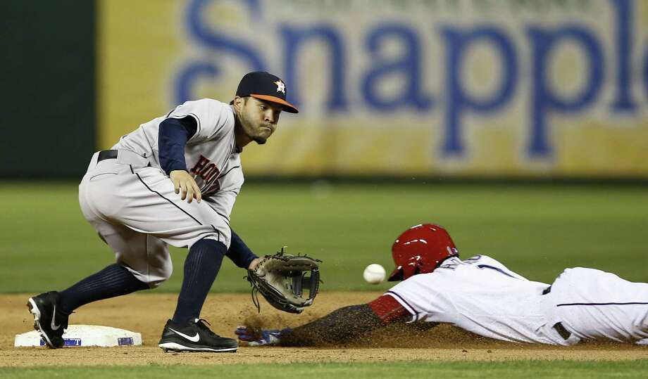 Rangers shortstop Elvis Andrus slides safely into second base, beating the throw to Jose Altuve of the Astros in the eighth inning. Photo: Jim Cowsert / Associated Press / FR170531 AP
