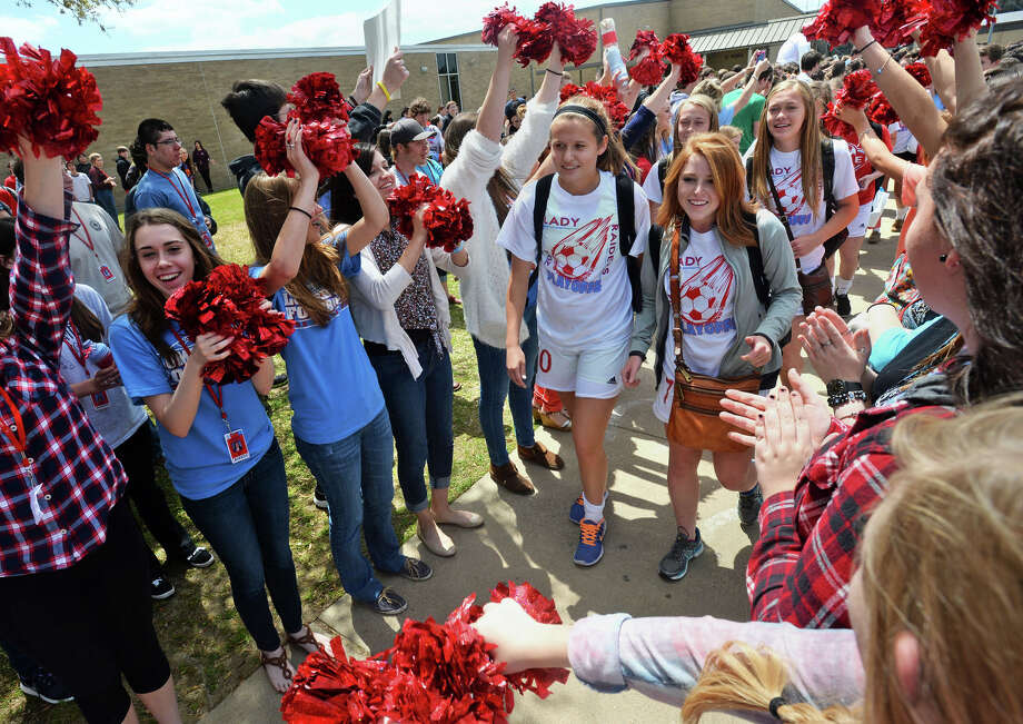 Lumberton soccer players are cheered on by students as they prepare to board a bus headed to the Regional Semifinals in Humble.  Photo taken Friday, April 11, 2014 Guiseppe Barranco/@spotnewsshooter Photo: Guiseppe Barranco, Photo Editor