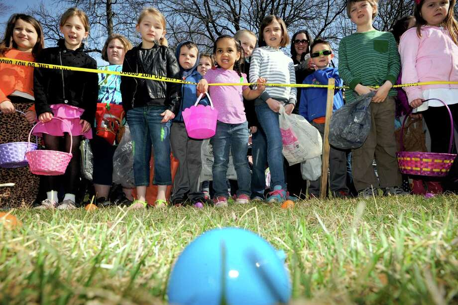 Children in the Ages 5 to 8 group anxiously wait for the start of the Cohoes Annual Easter Egg Hunt sponsored by The Lansing Street Neighborhood Watch and The City of Cohoes Human Services Department on Saturday April 12, 2014 in Cohoes, N.Y. (Michael P. Farrell/Times Union) Photo: Michael P. Farrell / 00026456A
