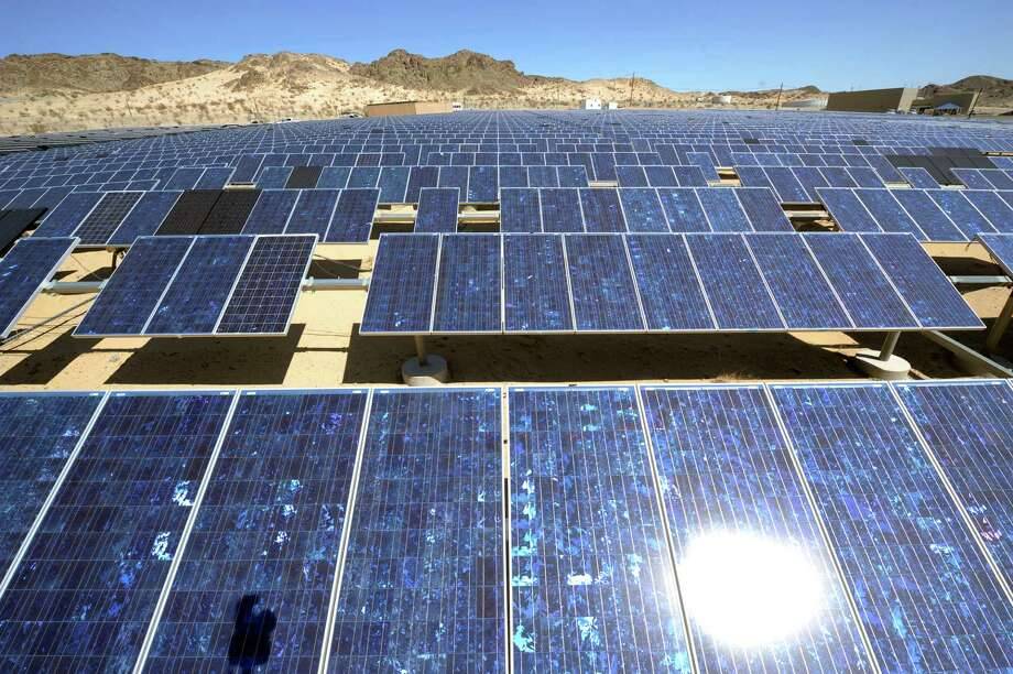 IMAGE DISTRIBUTED FOR THE PEW CHARITABLE TRUSTS - Solar array at the Marine Corps Air Ground Combat Center on Tuesday, March 25, 2014, in Twentynine Palms, Calif. The Combat Center currently has 4.5 Megawatts (MW) of solar panels installed on sunshades, rooftops, and the ground. (Rodrigo Pena/AP Images for The Pew Charitable Trusts) ORG XMIT: CPA710 Photo: Rodrigo Pena / AP2014