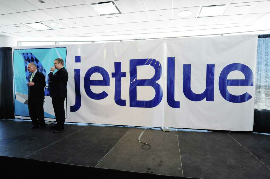 Senator Charles Schumer, left, and Robin Hayes, president of JetBlue airlines, talk on stage following an event on Monday, March 17, 2014, in Albany, N.Y., to announce that the airline will begin servicing the  Albany International Airport.   (Paul Buckowski / Times Union) Photo: Paul Buckowski / 00026177A