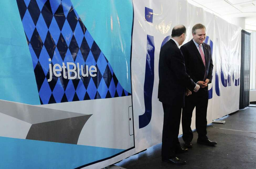 John O'Donnell, left, director of Albany International Airport, talks with Robin Hayes, president of JetBlue airlines following an event on Monday, March 17, 2014, in Albany, N.Y., to announce that the airline JetBlue will begin servicing the Albany International Airport. (Paul Buckowski / Times Union)