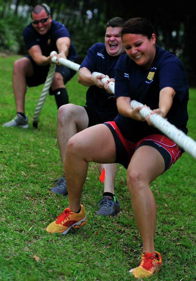 Ileana Jaquez, 23, with the Port Arthur Police Department stands in front to help her team win a game of tug-o-war. Beaumont and Port Arthur police officers and fire fighters competed Saturday in the 2014 Shields & Axes tournament. Teams competed for bragging rights and money for their department by playing dodgeball, tug-o-war and several other events. The event was hosted by CHRISTUS Health & Wellness Center in Beaumont. Photo by Cassie Smith/@smithcassie. April 12, 2014.