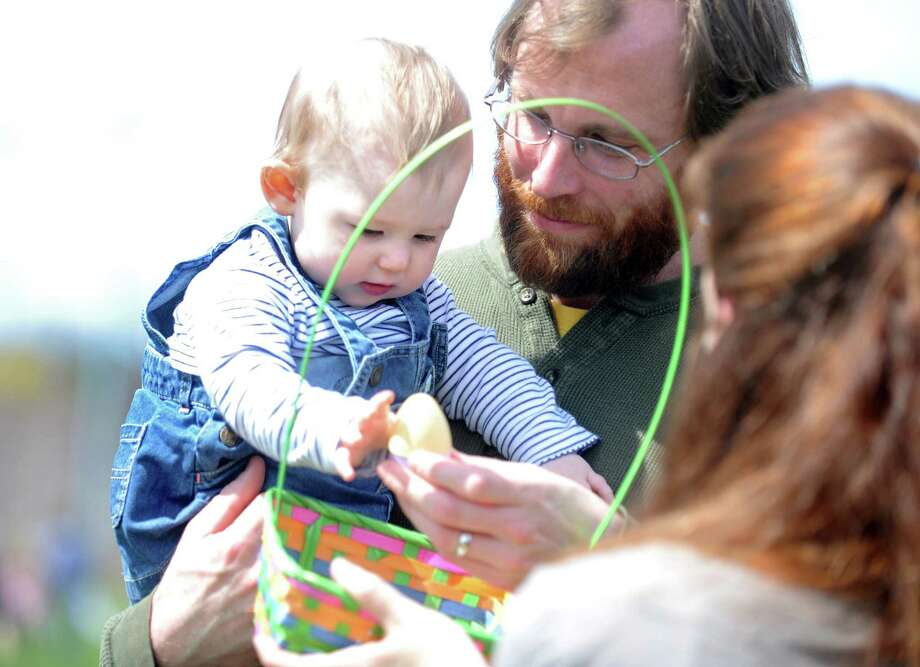 Hundreds turned out to meet the Easter Bunny and collect treasure-filled eggs during the annual Easter Egg Hunt, Saturday, April 12, 2014, at the South Pine Creek soccer field in Fairfield, Conn. Photo: Autumn Driscoll / Connecticut Post