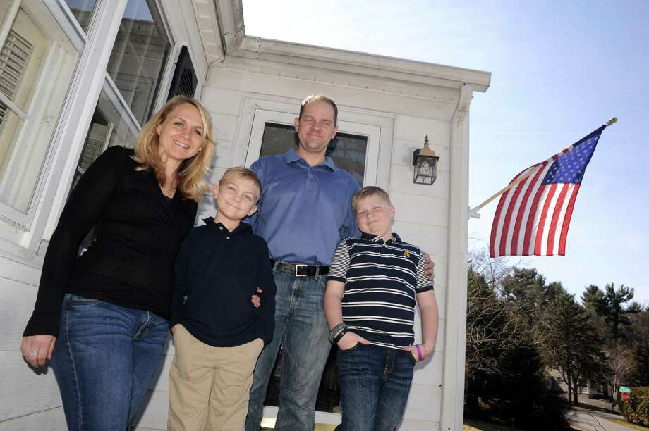 Jennie & Jeff Heidbreder with their two sons Evan, 7-years-old, and Ben, ten-year-old , at home on Thursday April 10, 2014 in Latham, N.Y. The Heidbreders moved here from Houston 5 years ago. There are several things they love about living in upstate NY, but it was a big adjustment. (Michael P. Farrell/Times Union) Photo: Michael P. Farrell / 00026411A