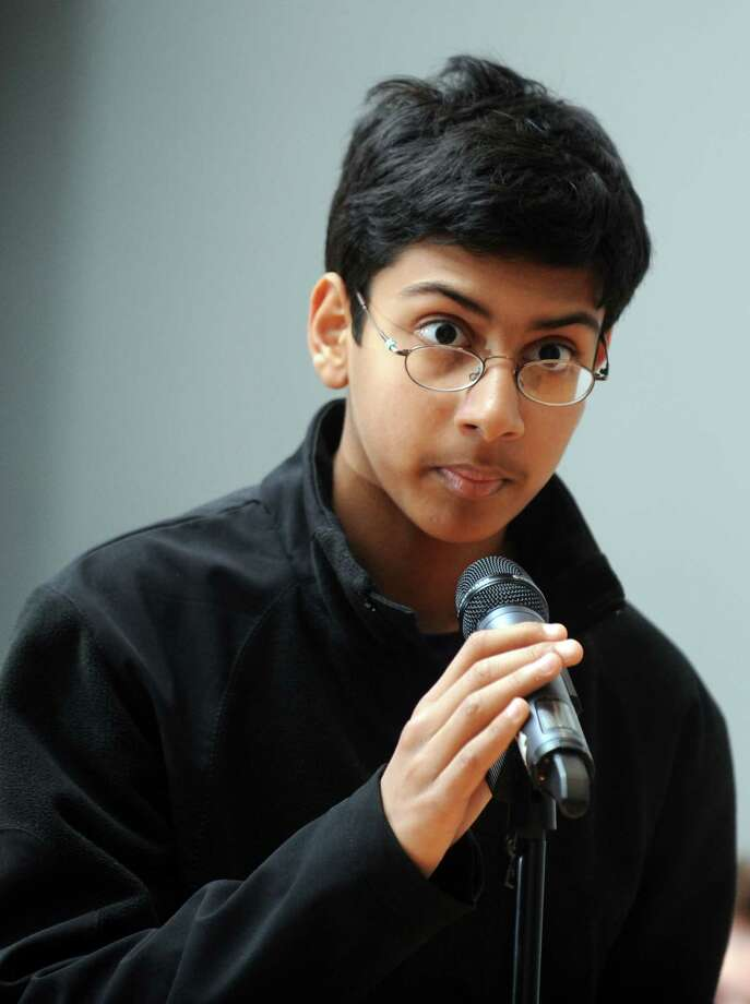 Seventh-grader Arjun Jagjivan, of West Hartford, spells a word for the judges Saturday, April 12, 2014, during the Scripps National Spelling Bee in Bridgeport, Conn. Photo: Autumn Driscoll / Connecticut Post
