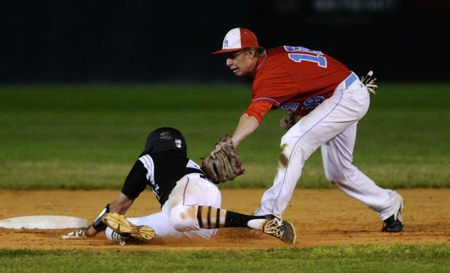 Lumberton's Ryan Erickson, No. 18, tags out Vidor's Paul Frecia, No. 4, at second base during Friday's game. Vidor played against Lumberton at Vidor on Friday night.  Photo taken Friday, 4/11/14 Jake Daniels/@JakeD_in_SETX Photo: Jake Daniels / ©2014 The Beaumont Enterprise/Jake Daniels