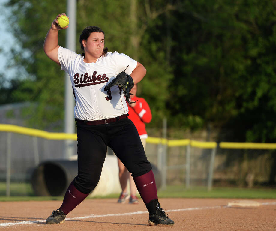 Silsbee's Lauren Gilbert, No. 3, winds up for a throw to first base during Friday's game against Bridge City. Bridge City played against Silsbee at Bridge City on Friday afternoon. Photo taken Friday, 4/11/14 Jake Daniels/@JakeD_in_SETX Photo: Jake Daniels / ©2014 The Beaumont Enterprise/Jake Daniels