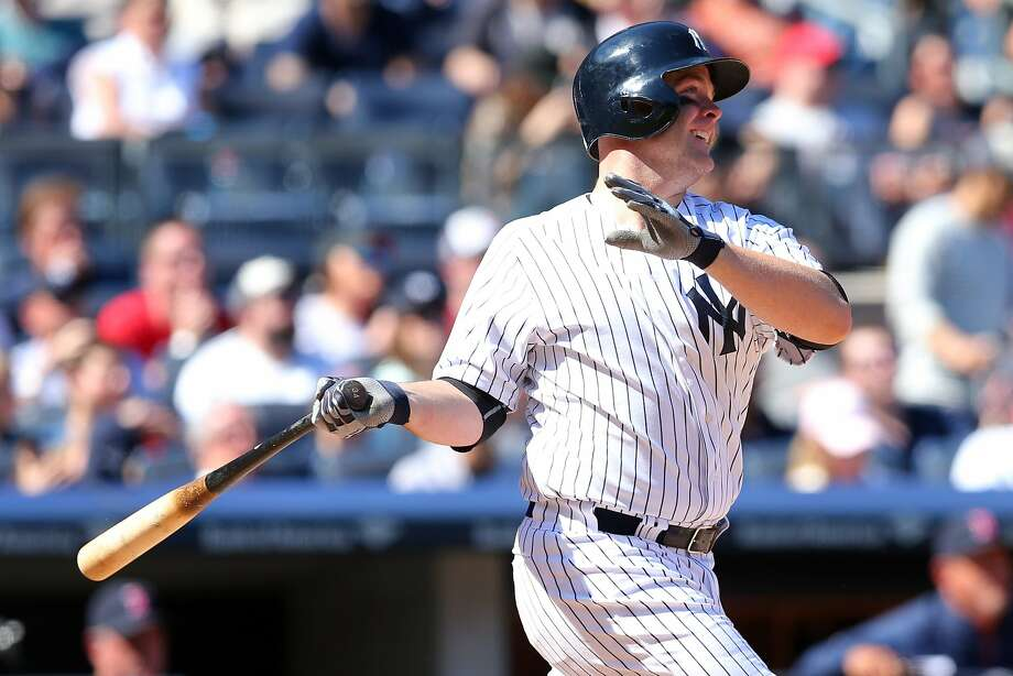 Apr 12, 2014; Bronx, NY, USA; New York Yankees catcher Brian McCann (34) hits a two-run home run against the Boston Red Sox during the sixth inning of a game at Yankee Stadium. Mandatory Credit: Brad Penner-USA TODAY Sports Photo: Brad Penner, Reuters
