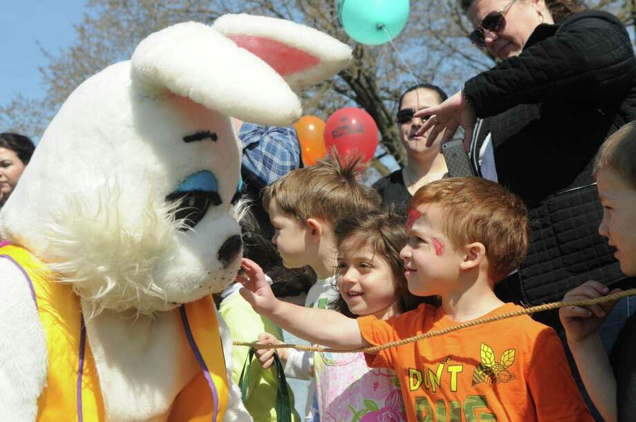 Mario Laudieri,4 and Piper Jane Reynolds, 4, chat with the Easter Bunny during the Greenwich Lions Club Easter Egg Hunt at Roger Sherman Baldwin Park in Greenwich, Conn., April 12, 2014. Photo: Keelin Daly / Stamford Advocate Freelance