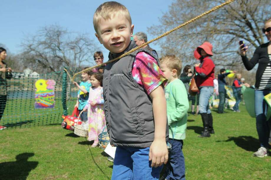 Santiago Fajardo, 5, puts pressure on the gatekeepers as he waits for his egg hunting heat to begin during the Greenwich Lions Club Easter Egg Hunt at Roger Sherman Baldwin Park in Greenwich, Conn., April 12, 2014. Photo: Keelin Daly / Stamford Advocate Freelance