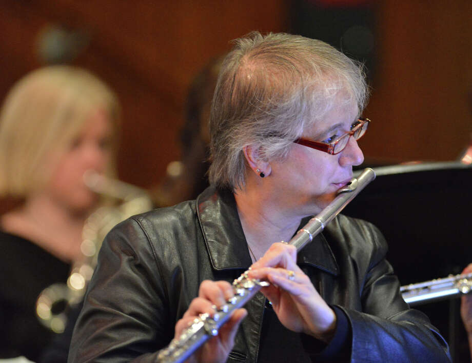 "Norwalk resident Nanette Jordan plays the flute as part of the orchestra during the Troupers Light Opera production of ""The Pirates of Penzance"" at Rippowam Middle School in Stamford, Saturday afternoon, April 12, 2014. Photo: Bob Luckey / Greenwich Time"