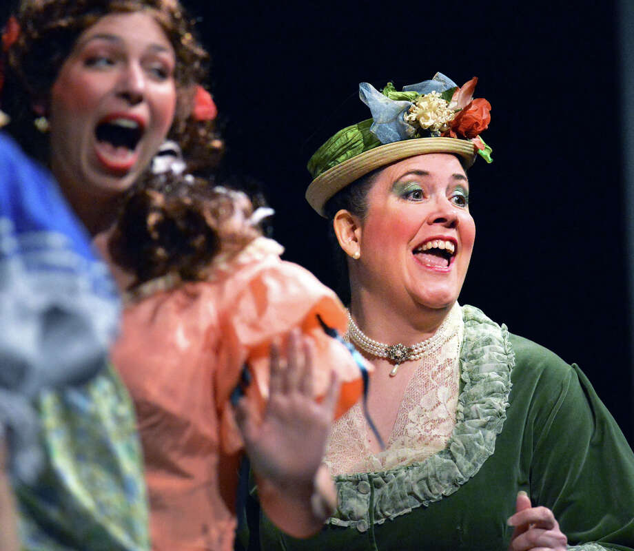 "At right, Stamford resident Wendy Falconer as Kate during the Troupers Light Opera production of ""The Pirates of Penzance"" at Rippowam Middle School in Stamford, Saturday afternoon, April 12, 2014. Falconer is president of the company. Photo: Bob Luckey / Greenwich Time"