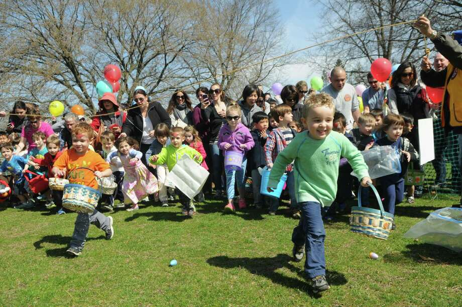 The race beings at the Greenwich Lions Club Easter Egg Hunt at Roger Sherman Baldwin Park in Greenwich, Conn., April 12, 2014. Photo: Keelin Daly / Stamford Advocate Freelance