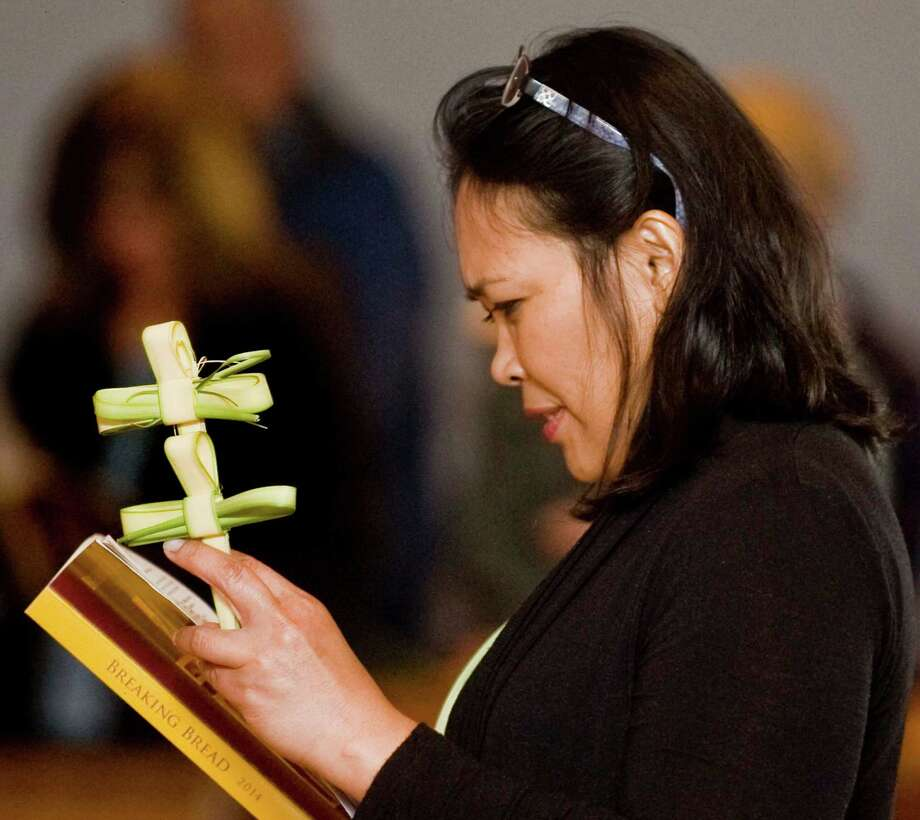 Darlina Mejarus of Danbury with a palm she crafted during the Saturday Palm Mass at St. Gregory the Great Church in Danbury. Saturday, April 12, 2014 Photo: Scott Mullin / The News-Times Freelance