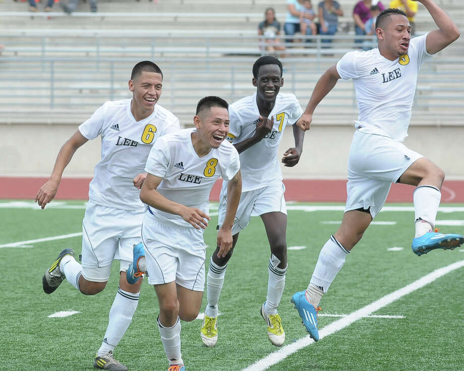 With a clinching goal by Salvador Lopez (8) in overtime, Lee's players know they are finally state bound. Photo: Â Tony Bullard 2014, Freelance Photographer / © Tony Bullard & the Houston Chronicle