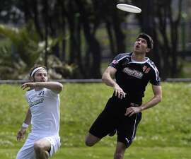Mac Taylor (40) of the San Francisco Dogfish focuses on the frisbee in a Major League Ultimate professional frisbee game against Donnie Clark (left) and the Seattle Rainmakers at Balboa Park in San Francisco, Calif. on Saturday, April 12, 2014.