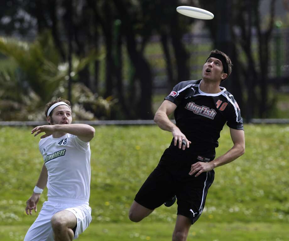 Mac Taylor (right) of the San Francisco Dogfish focuses on the Frisbee in the Major League Ultimate opener against Donnie Clark and the Seattle Rainmakers at Balboa Park in S.F. Photo: Paul Chinn, The Chronicle