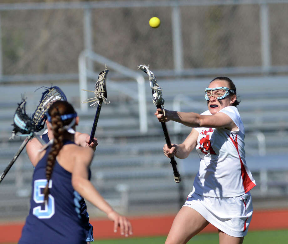 At right, Amy Wyle (#24) of Greenwich shoots past Suffern's Tonieanne Manelli (#5) during the girls lacrosse match between Greenwich High School and Suffern High School at Greenwich, Saturday, April 12, 2014. Suffern defeated Greenwich, 15-5. Photo: Bob Luckey / Greenwich Time