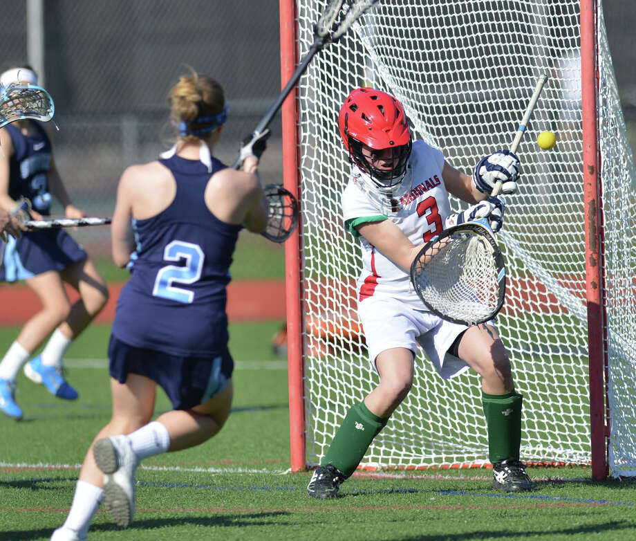 Suffern's Caitlin Leary (#2) scores past Greenwich goalie Nanny Burke, right, during the girls lacrosse match between Greenwich High School and Suffern High School at Greenwich, Saturday, April 12, 2014. Suffern defeated Greenwich, 15-5. Photo: Bob Luckey / Greenwich Time