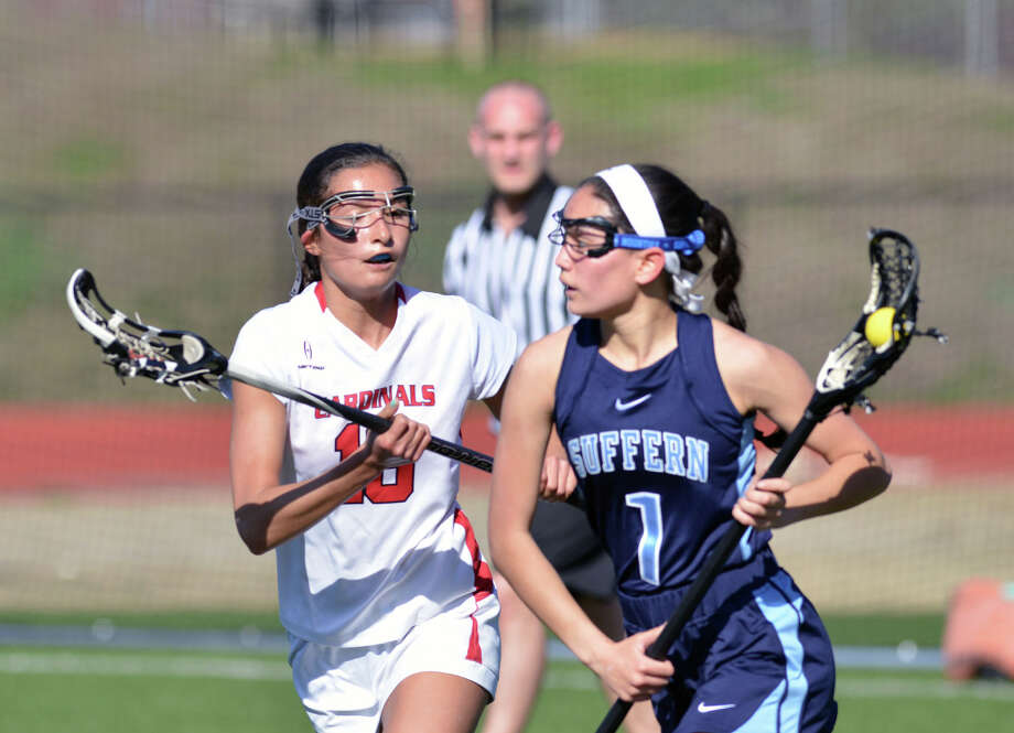 At left, Natalle Paletta of Greenwich (#18) covers Suffern's Baley Parrot (#1) during the girls lacrosse match between Greenwich High School and Suffern High School at Greenwich, Saturday, April 12, 2014. Suffern defeated Greenwich, 15-5. Photo: Bob Luckey / Greenwich Time