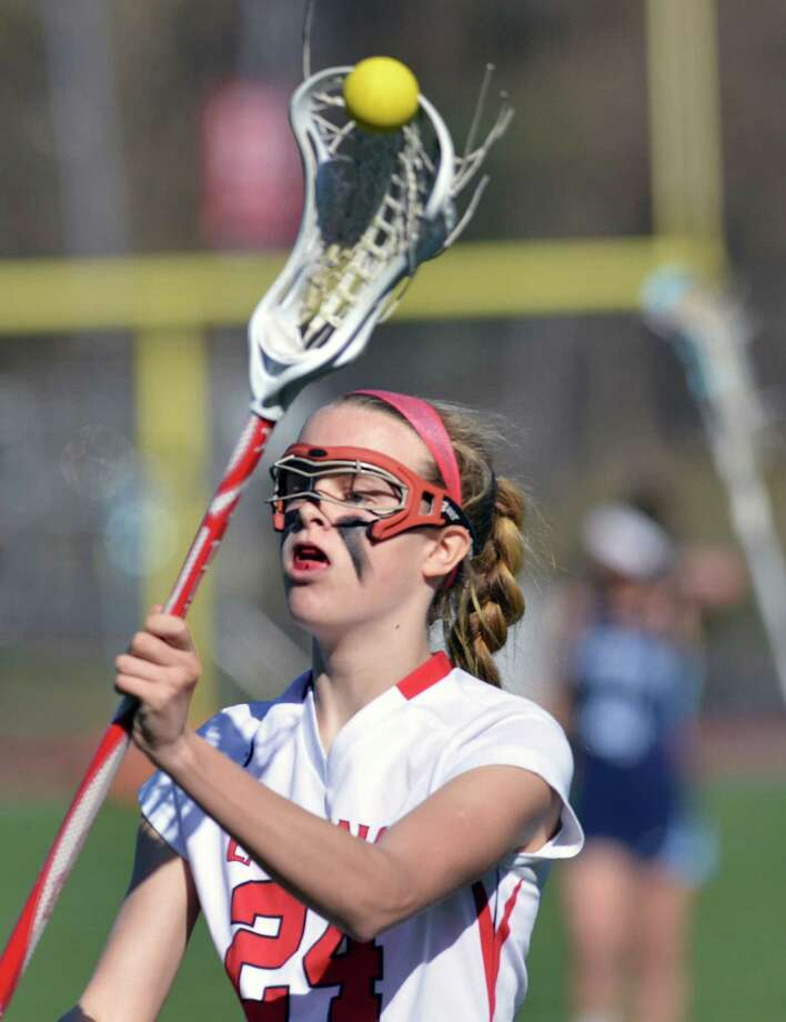 Amy Wyle (#24) of Greenwich passes the ball during the  lacrosse match between Greenwich High School and Suffern High School at Greenwich, Saturday, April 12, 2014. Suffern defeated Greenwich, 15-5. Photo: Bob Luckey / Greenwich Time