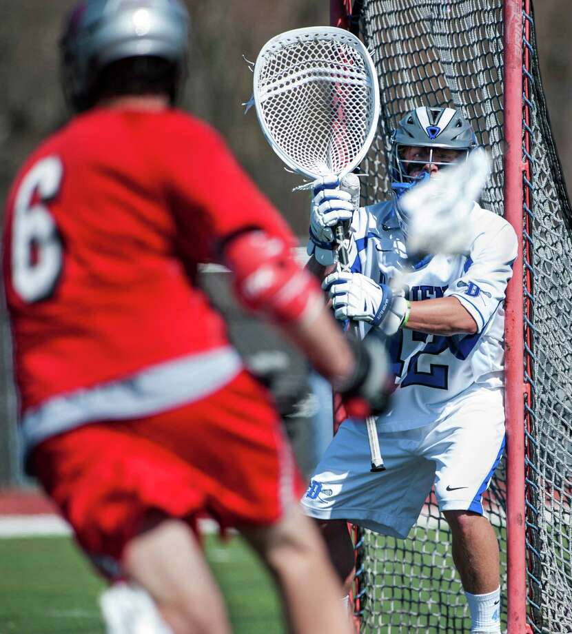 Darien high school goalie Paul Huffard prepares for a shot on goal by Niskuyuna, NY high school's Ryan Lawson during a boys lacrosse game played at Darien high school, Darien, CT on Saturday, April, 12th, 2014. Photo: Mark Conrad / Connecticut Post Freelance