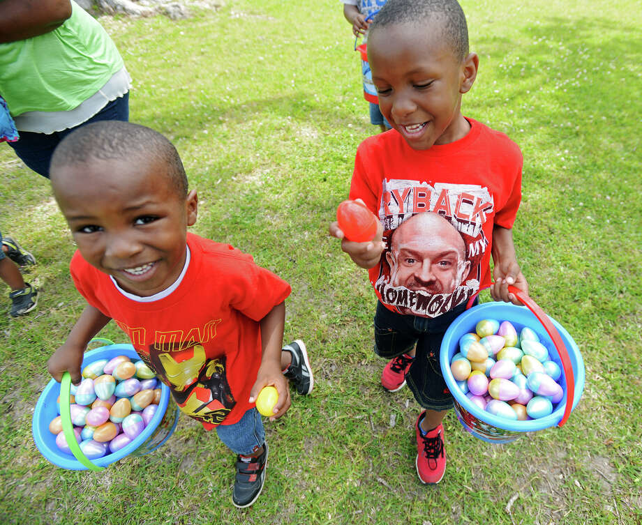 Christian, 4, and Jaiden Sheppard, 5, left and right, carry Easter eggs in buckets during Saturday's Easter egg hunt at Magnolia Park. Photo taken Saturday, 4/12/14 Jake Daniels/@JakeD_in_SETX Photo: Jake Daniels / ©2014 The Beaumont Enterprise/Jake Daniels