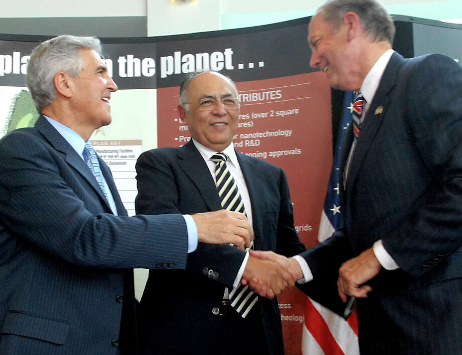 Hector Ruiz, CEO and chairman of Advanced Micro Devices Inc. (AMD), center, shakes hands with Gov. George Pataki, right, and Sen. Joseph Bruno, left, during a news conference on Friday, June 23, 2006, at CESTM in Albany, N.Y.  (Cindy Schultz /Times Union archive) Photo: CINDY SCHULTZ / ALBANY TIMES UNION