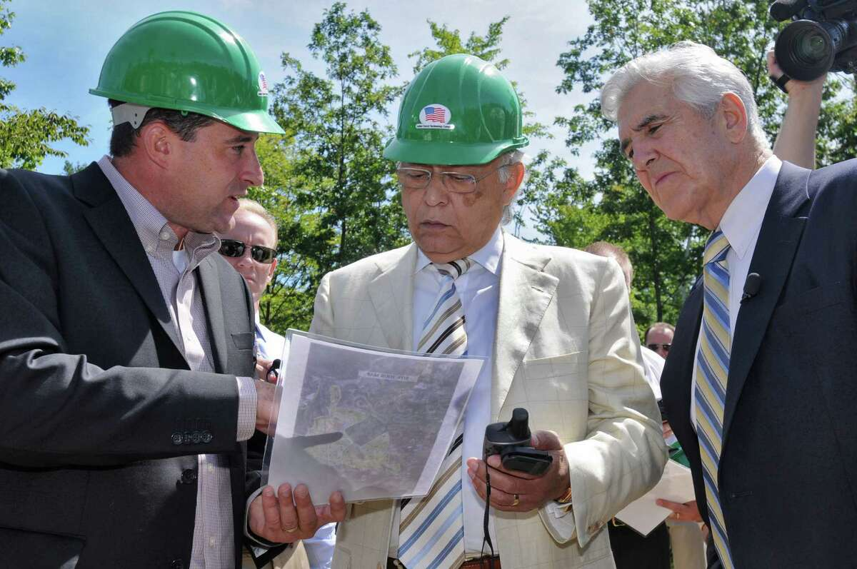 Mike Relyea, president of Luther Forest Technology Campus, left, Hector Ruiz, CEO and chairman of Advanced Micro Devices Inc. (AMD), and Sen. Joe Bruno, right, use a site tour map and a GPS device to check out the campus during a tour of the Luther Forest Technology Campus Aug. 27, 2008, in Malta, N.Y. (Lori Van Buren /Times Union archive)