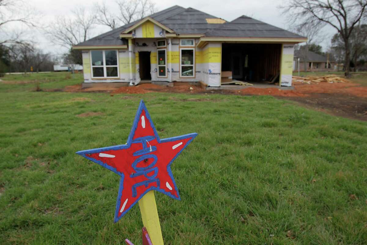 Construction work on a home destroyed by the fertilizer plant explosion in April of 2013 Tuesday, March 25, 2014, in West.