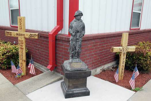 A memorial outside the City of West Volunteer Fire Department for firefighter who were killed in the fertilizer plant explosion in April of 2013 Tuesday, March 25, 2014, in West. Photo: James Nielsen, Houston Chronicle / © 2014  Houston Chronicle